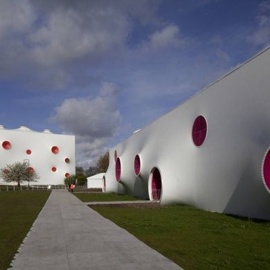 Olympic Shooting Venue: Location: London, UK Year of Construction: 2012 Architects: Magma Architecture  A white double wall curved membrane covers the shooting ranges along with brightly colored openings that also function as ventilation.