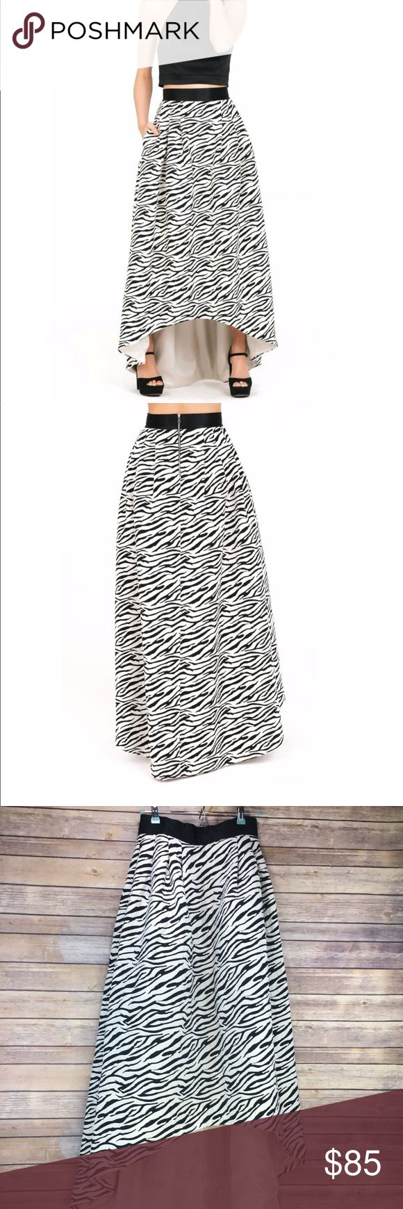 "High-low Zebra Print Skirt Amazing!!! New without tags- I bought this over the summer at a boutique near me, but never wore it.   It is an off-white white, heavy quality fabric. Beautiful structure! Not too heavy that you should be uncomfortable. Not a cheap material. Has two pockets!  Cannot be bundled due to weight!  Size 8, RUNS SMALL IN WAIST! I am 5'6"" 135lbs, and this is the perfect size for me.  Please see measurement photo to ensure fit prior to purchase. All measurements are…"