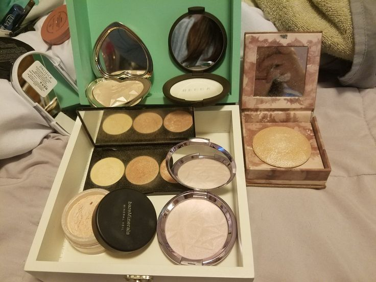 my best highlighters.  top right to left: Too Faced, Blinded by the Light; Becca, Pearl; Urban Decay, Naked Illuminated; Smashbox, Spotlight Palette-Pearl; Bare Minerals, Illuminating Mineral Veil; Becca, Prismatic Amethyst.