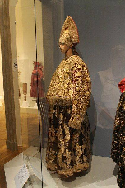 Traditional Russian costume. Kokoshnik, shugay (warm jacket), sarafan