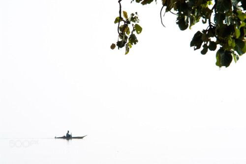 Early Morning - Fishermen riding a boat on Lake Tana Ethiopia -... -  Early Morning - Fishermen riding a boat on Lake Tana Ethiopia - by _tom - http://ift.tt/1VAUqlF