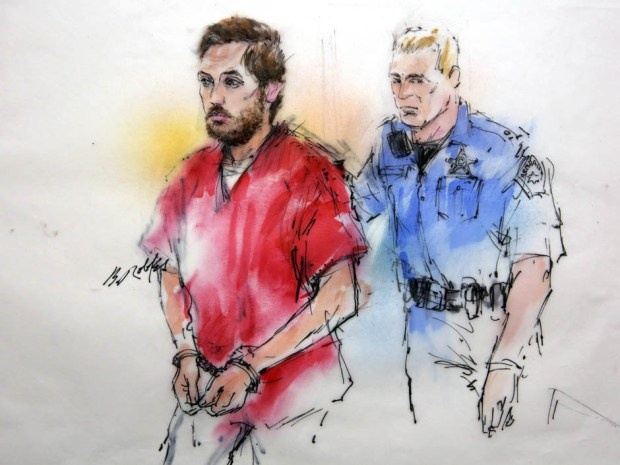 Preliminary Hearing Jan 7, 2013.  James Holmes being escorted by a deputy as he arrives at preliminary hearing in district court in Centennial, Colo., on Monday. http://news.nationalpost.com/2013/01/07/after-aurora-massacre-officer-found-james-holmes-very-very-relaxed-and-armed-to-the-teeth-court-hears/