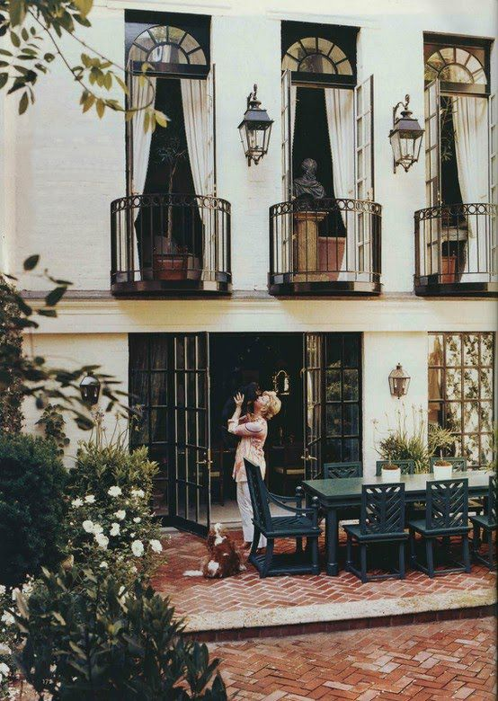 the bricks, the french doors, the sconces, the wrought iron balconies,...
