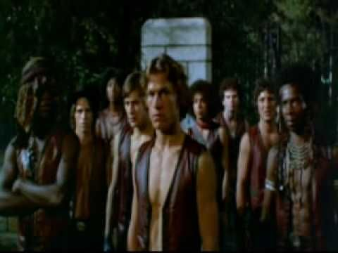 """The Warriors. A 70's film about a """"gang"""" (all gangs apparently dress up like it's Halloween in their reality) which was framed for killing a gang leader, and must try to get across New York with all the other gangs after them. What's even more awesome is that it's based on the Anabasis by Xenophon. Chock full of Cheesy Goodness. """"Waaaa-riors. Come out and PLAY-AY!!!!"""""""