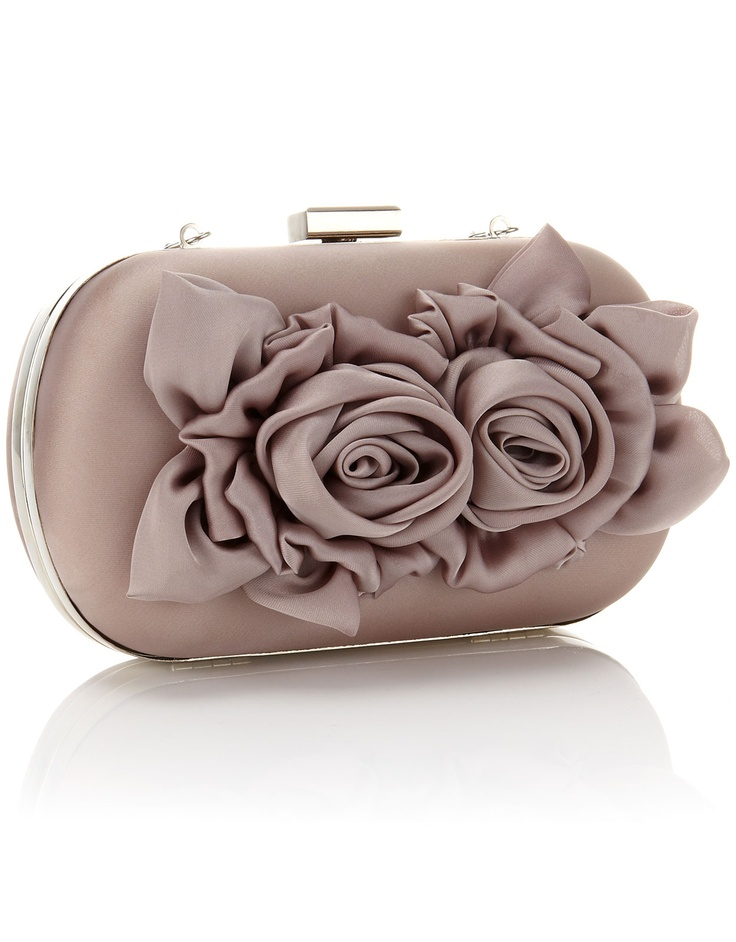 Complete you look with our flower detail hard case clutch.