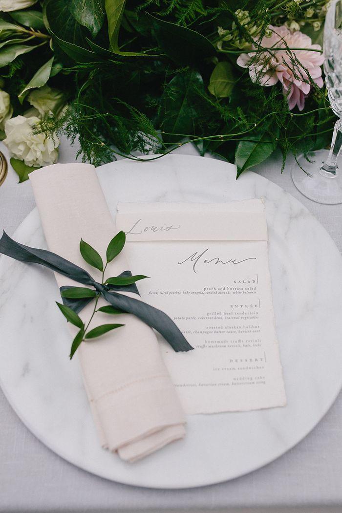 Marble and Greenery Wedding Place Setting  https://heyweddinglady.com/magical-rainy-wedding-day-on-lake-tahoe/    #wedding#weddinginspiration#weddings#destinationwedding#travel#laketahoe#blacktiewedding#weddingdecor #weddingdetails #placesetting