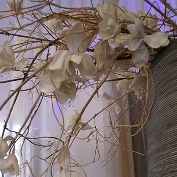 Foam flowers in an enormous wooden vase