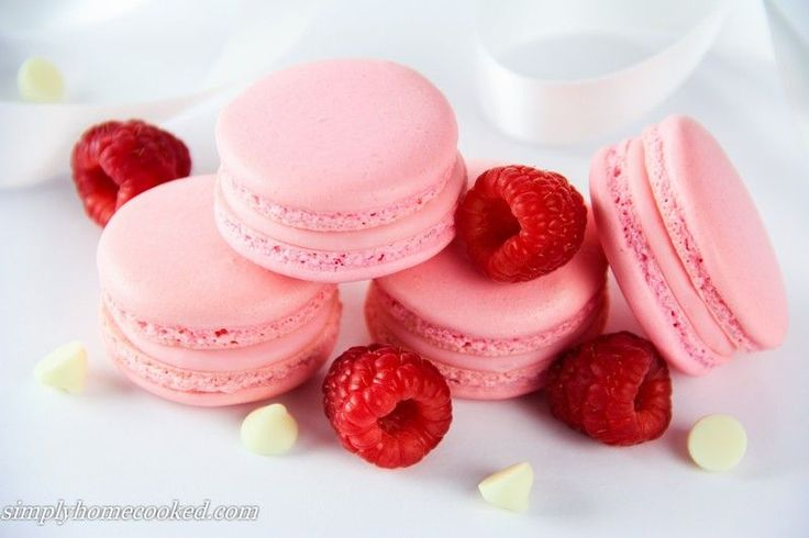 These white chocolate raspberry macarons are beyond perfect for a bridal or baby shower. When I just started experimenting with this recipe I really wanted to use real raspberries instead of raspberry extract. But in order to get a decent raspberry flavor I had to put so many raspberries that the chocolate filling changed into