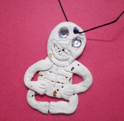 Bone carving hei tiki necklace