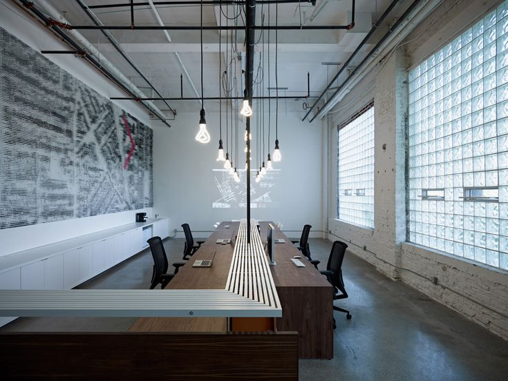 BLACKLABORATORY -  an extended desk serves welcomes people to the office, supports workstations and transitions into meeting space