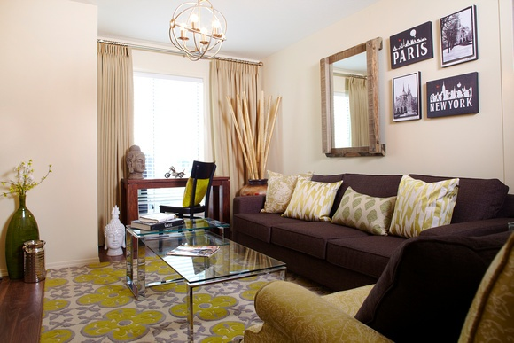 Love the purple and green decor pieces in this Verde townhome.