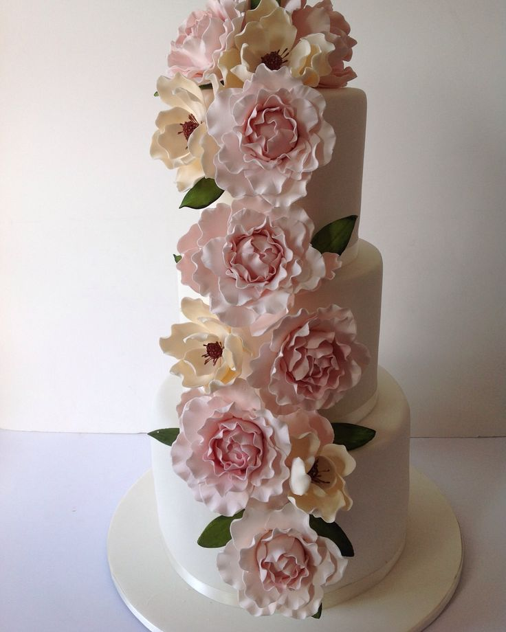 Cascading flowers wedding cake #wedding cake