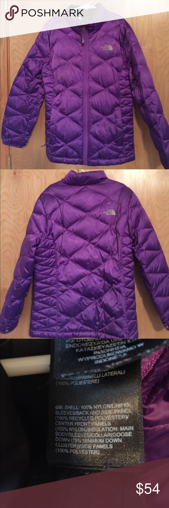North Face big girls winter jacket size M 10-12 North Face big girls winter jacket in a gorgeous purple. Gently worn by 1 child. All zippers work. I'm trying to look for stains but I don't see any. Is possible there might be a stain that didn't come out. My daughters name is written on the inside. This was very warm in our snowy weather here in Montana The North Face Jackets & Coats Puffers