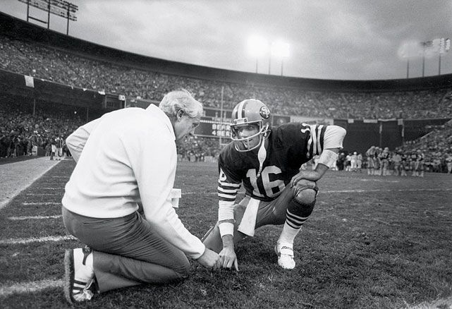 49ers head coach Bill Walsh talks with quarterback Joe Montana during the 1984 NFC Championship Game against the Chicago Bears at Candlestic...