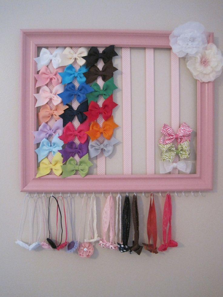 Hair bow and headband organizer. Made from a painted picture frame, hooks and ribbons. This would make an adorable gift, fully stocked, of course!