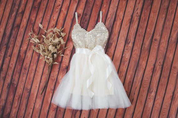 This dress is just beautiful! It includes a gold sequined bodice with gold elastic spaghetti straps and an ivory tulle tutu skirt. It also has
