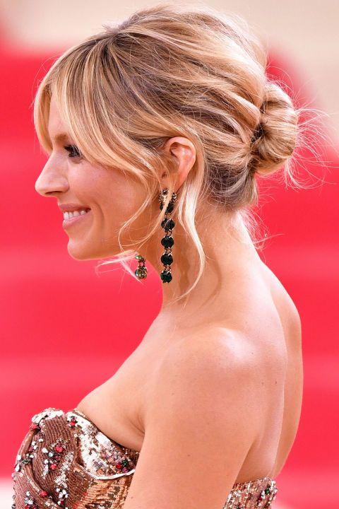 17 pretty and messy bun hairstyles to try this season: Sienna Miller's low bun