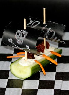 Created this cucumber boats for the boys pirate theme birthday party. Yo ho ho...hoist the sails, maties!