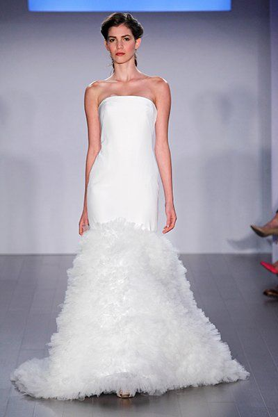 Gown by Jim Hjelm.Check out more gorgeous dresses in our Jim Hjelm wedding gown gallery ►