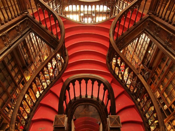 Lello Bookshop, Porto, Portugal   Opened in 1906, Lello is one of the world's most beautiful bookstores, thanks largely to its centerpiece: this glossy red staircase with carved wooden banisters that leads up to a glass atrium. The stairs are just as beautiful from underneath, with carved leaflike flourishes and the same bluish-green and gold paint as the ceiling above it. Look for lovely neo-Gothic and Art Nouveau elements to the rest of the shop as you browse.