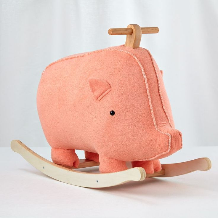 """Shop Plush Pig Rocking Horse. Forget going """"wee wee wee"""" all the way home (whatever that even means). Stay home and rock back and forth on This Little Piggy Rocking Horse. It features a plush pig on a sturdy, wooden frame."""