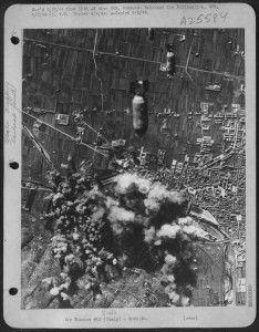 Bombs from Flying Fortresses of the 15th AAF fall on the marshalling yard at Prato, Italy, in a raid on 17 January 1944. The yards form an important link in the Germans' communication
