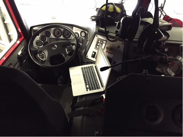 Mikey's office pic! Yep, he's a fireman.