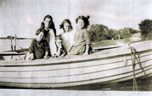 local children in a boat at Shelley Beach, circa 1925, Mayfield - before the BHP filled it in