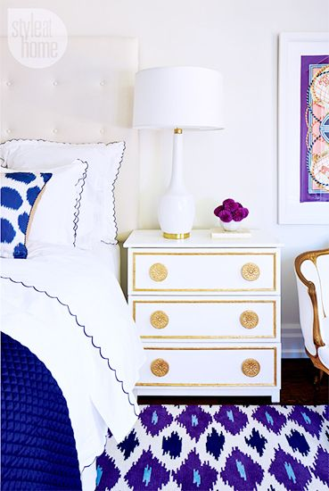 Tour a Design Editor's Own Bold Digs// white nightstand, patterned area rug, purple bedroom