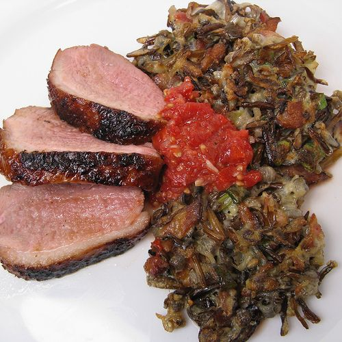 Grilled Duck Breast with Wild Rice Cakes  Sesame Tomato Chutney