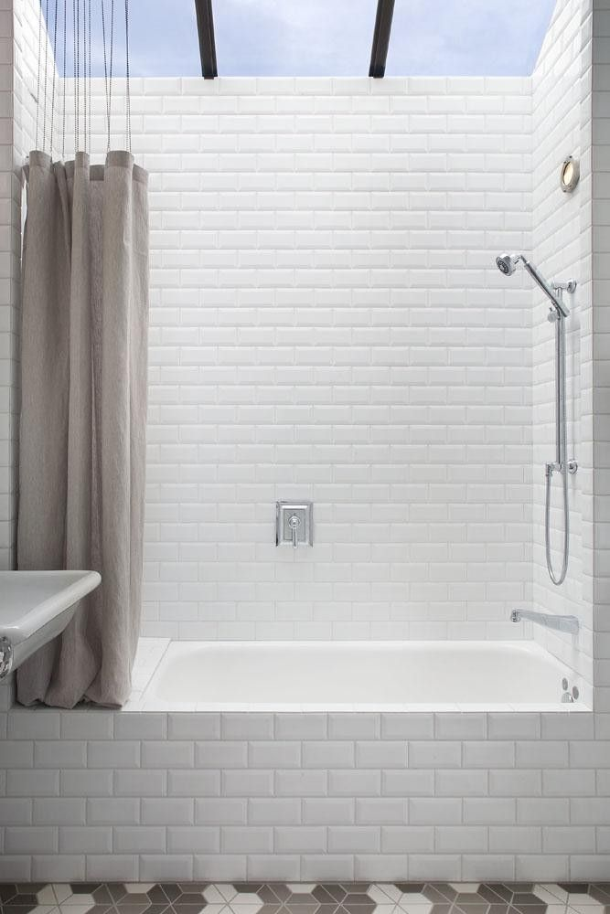 Love this look for her little bathroom.   Mark Reilly Architecture Built-In Bathtub with Skylight, Remodelista Like the shower curtain idea
