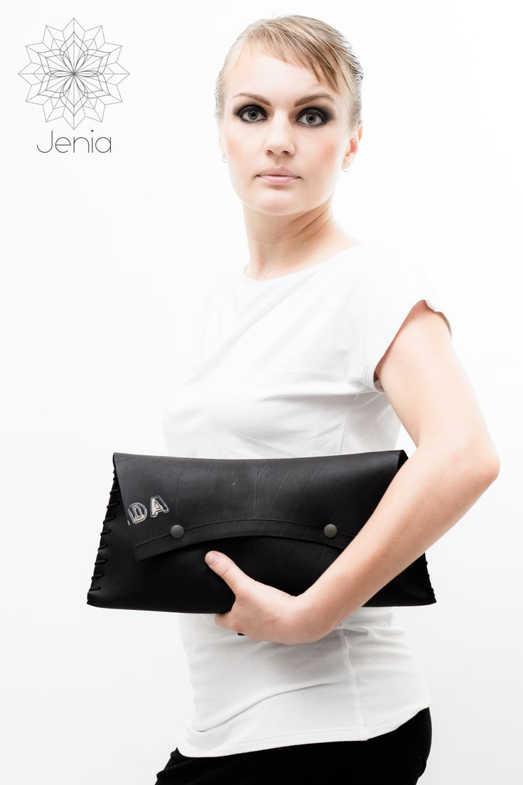 BAGUETTE 1 .  clutch bag   Tractor  inner tube, cotton twine, coated stainless steel  snap buttons.  www.jeniadesign.com