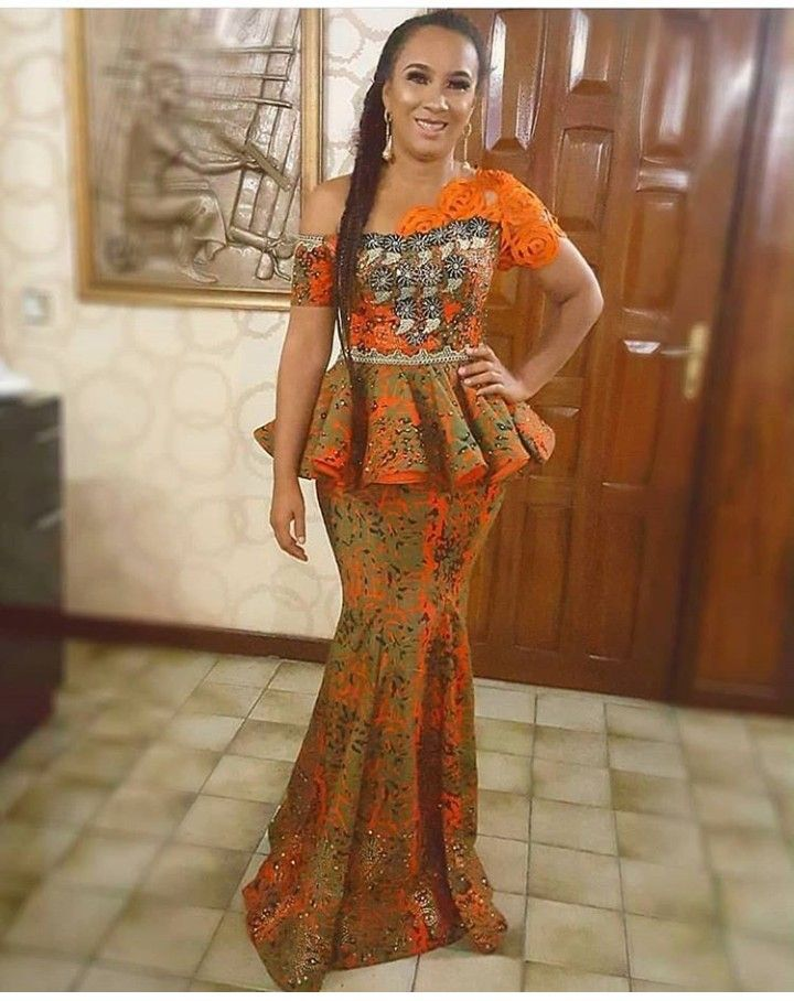 Green and orange African suit