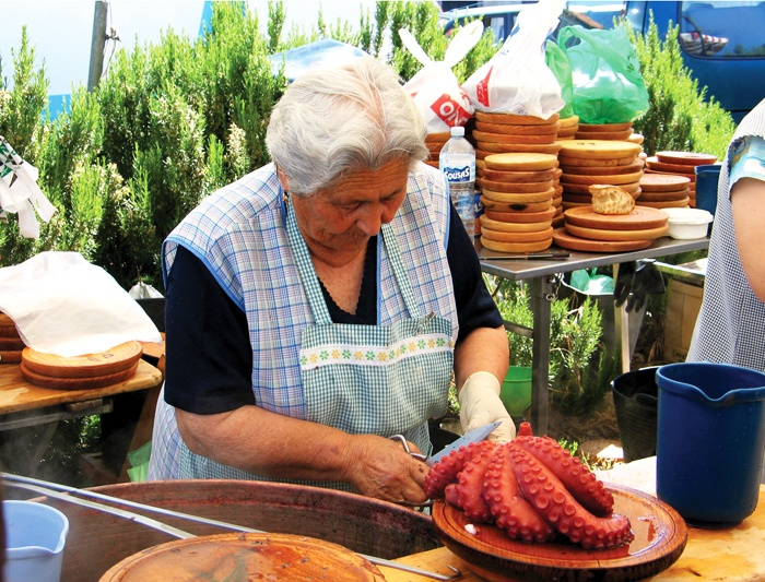 Galician woman preparing octopus