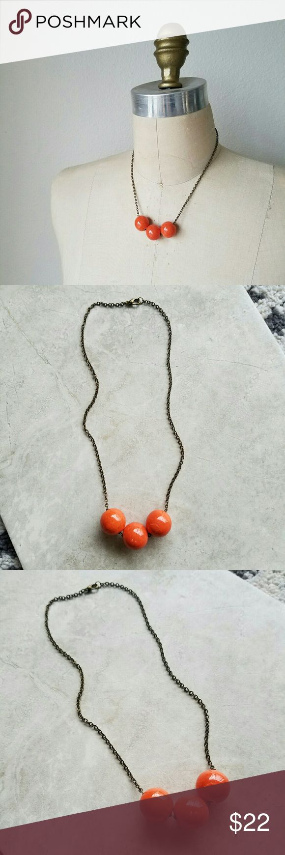"""Bubble Necklace A fun pop of color! Bright coral glazed ceramic beads on antiqued brass chain.  Necklace measures 18"""" around.  **Handmade in California. Anthro used for exposure. Anthropologie Jewelry Necklaces"""
