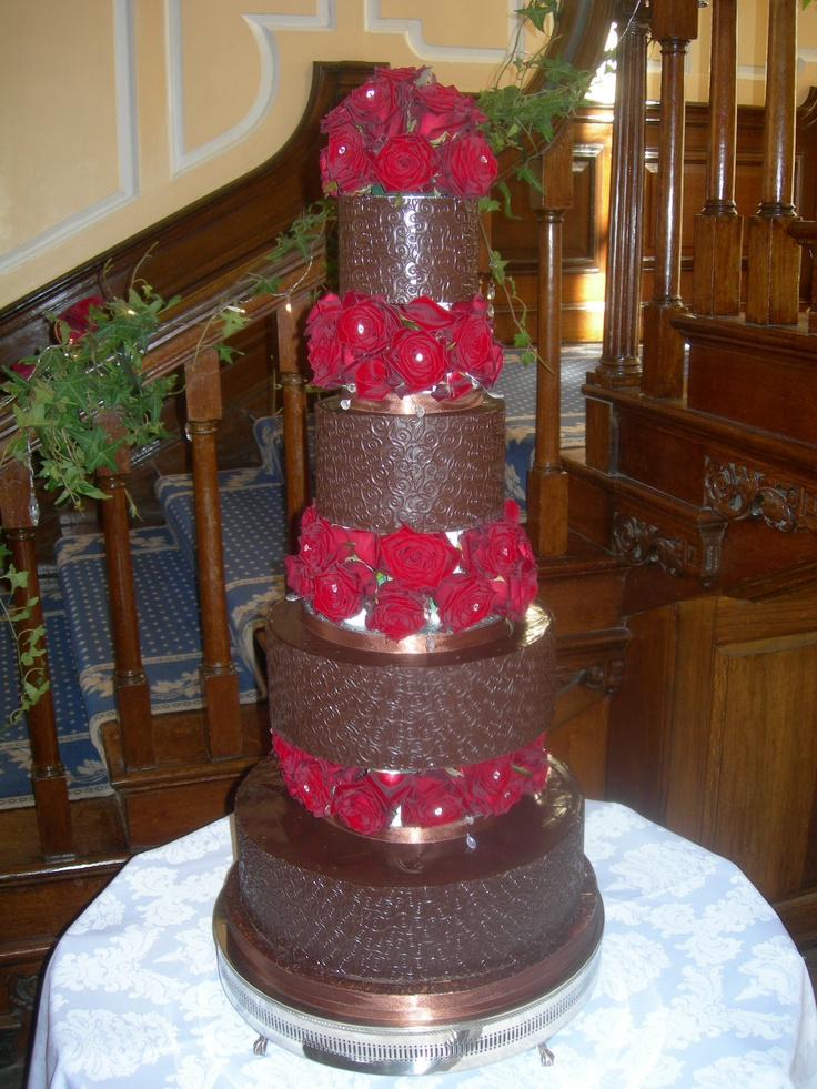 Filigree finished chocolate cake decorated with fresh Grand Prix roses - Gosfield Hall, Essex