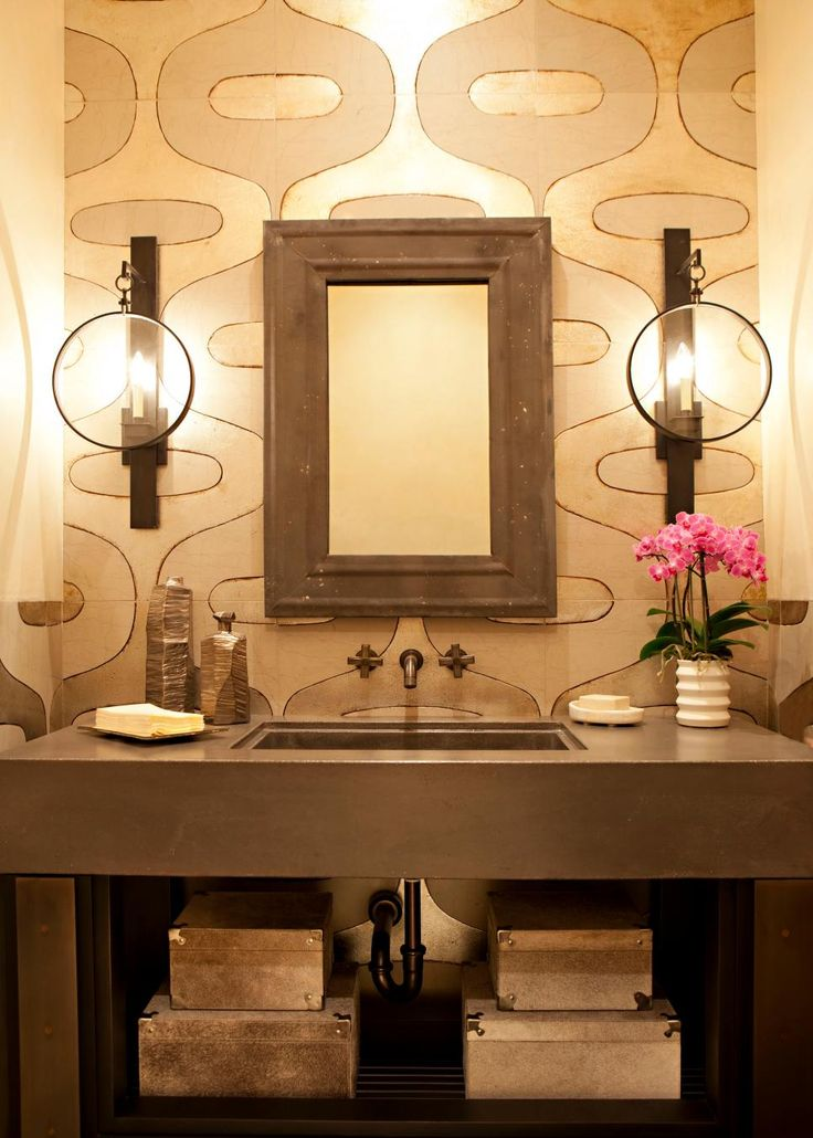 A bathroom is the perfect place to get a little daring in your design choices. Try a set of unusual sconces, an ornate chandelier or a set of funky pendants.