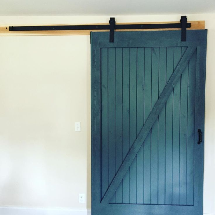 Blue Barn door by @repurposed_midwest with Rustica Hardware Industrial Stag Hanger.