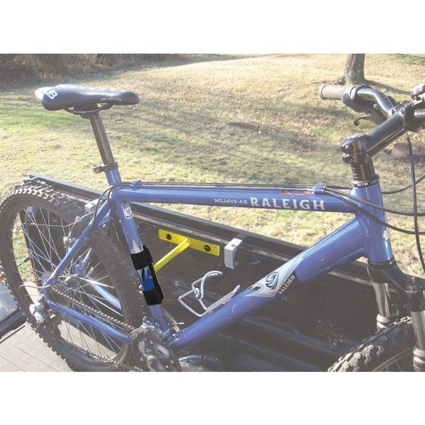 Keep bikes upright and off to the sides of your pickup truck bed with these neat, inexpensive bike racks from DiscountRamps.com