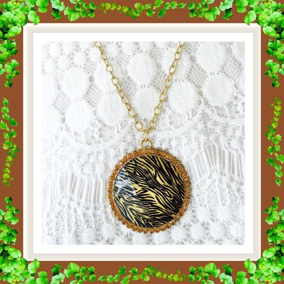 TRENDY ANIMAL PRINT PENDANT   This is a knockout pendant that is impossible to go unnoticed.  The medallion has a facet diamond cut.  It shimmers like one too. It is completely surrounded by complimentary colored crystal rhinestones.  It's a very unusual and gorgeous pendant.  Jewelry