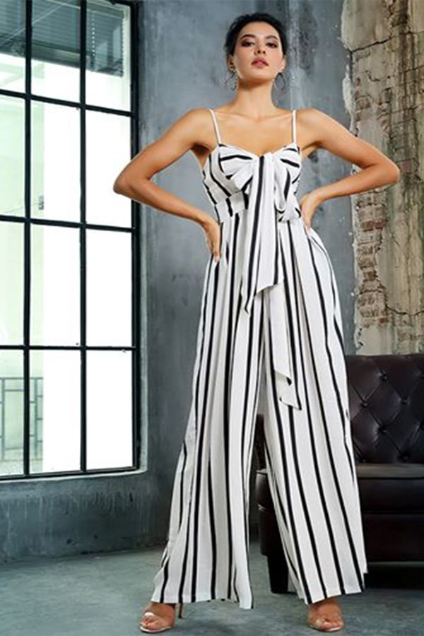 955874e2e74 Chic striped jumpsuit  89. Simple and chic is our black and white striped  jumpsuit with bow front spaghetti straps top and wide leg pants.