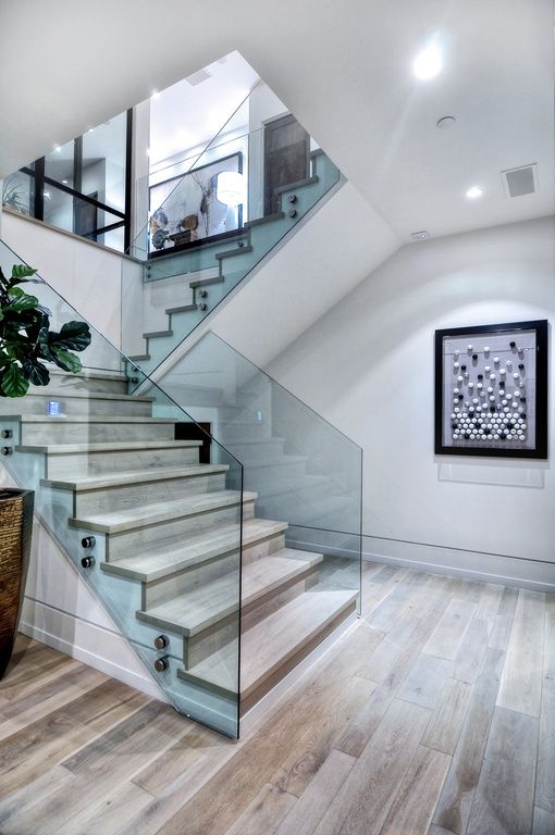 Modern Staircase with Glass staircase, Hardwood floors