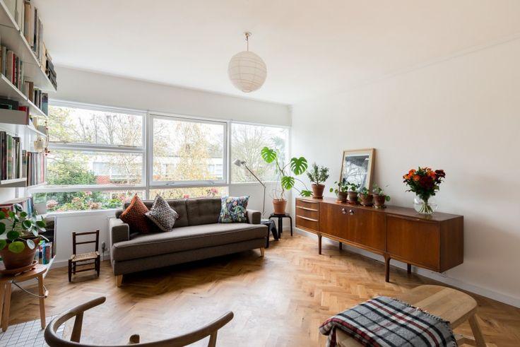eric lyons at parkleys richmond, lovely parquet floor, simple white skirting and large bookshelf