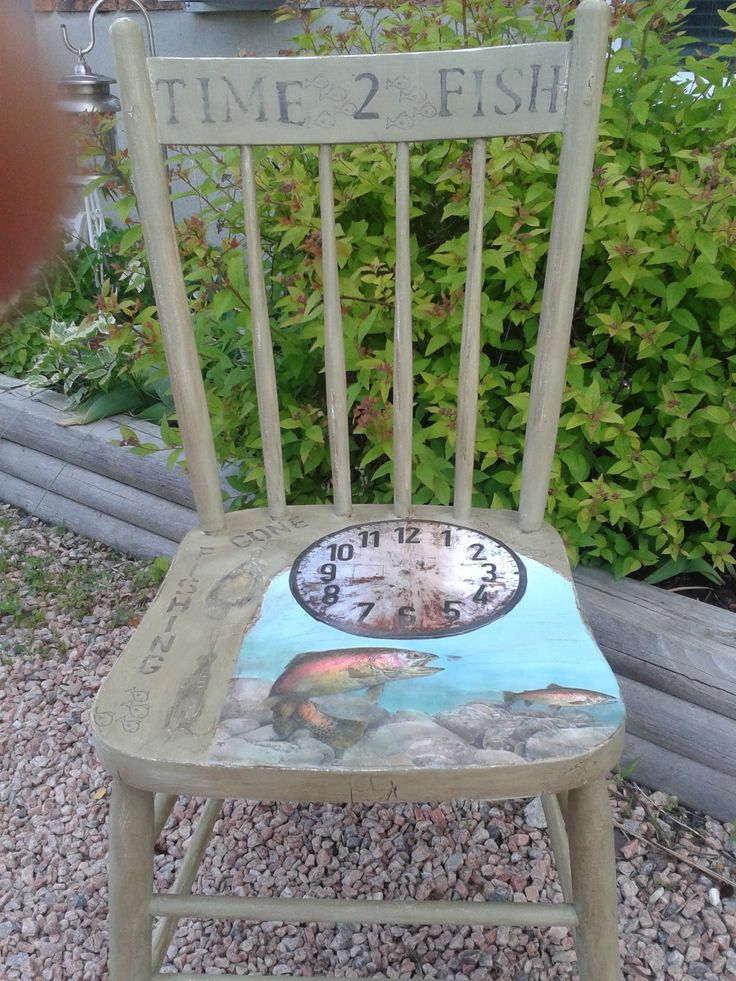 This vintage re purposed chair would look great in a cottage or rustic get away!  TIME 2 FISH has been painted in a safari color chalk style paint and dark glazed.  Fishing tackle images found on the Graphics Fairy site have been faintly added along with distressing for that aged cottage look. Fish themed and clock paper was used for my TIME 2 FISH theme.