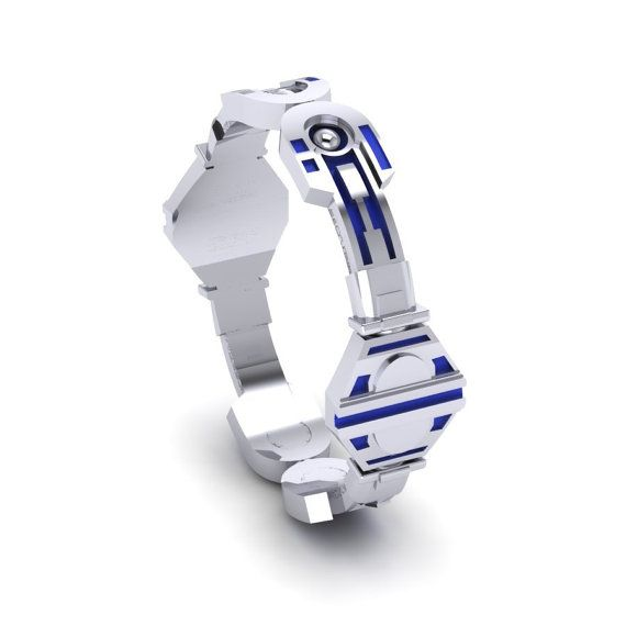 Star Wars | 11 Fabulously Geeky Wedding Rings What an adorable droid ring. Buy it here.