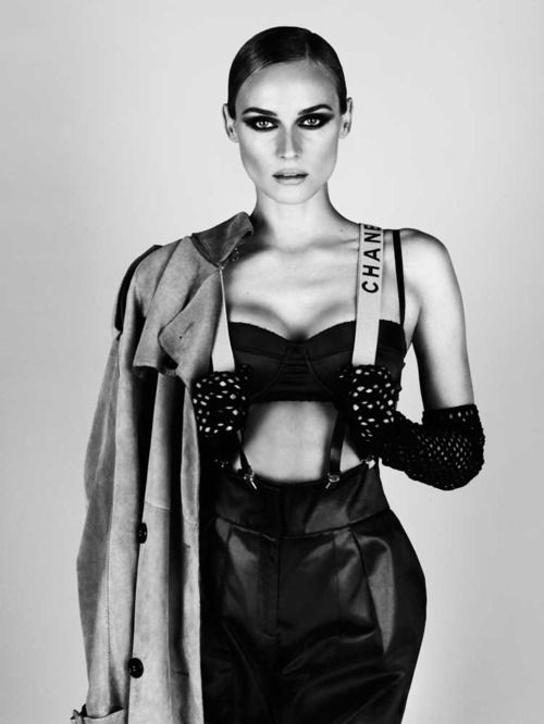 chanel model in  black pants, suspenders & long gloves