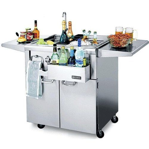 The CocktailPro Freestanding Beverage Station by Lynx. $2559.00. CS30F-1 Top Shelf Not Included Features: -Bottle boots for chilling juices, wines and mixes.-Speedrail front bottle storage for quick and easy access to bottles.-Insulated ice bin with sliding stainless steel cover holds ice for extended periods of time.-Drain board and slide-away cutting board.-Built-in bottle opener with integral cap catcher.-Convenient integrated towel holder.-Two fold-down shelves that ar...