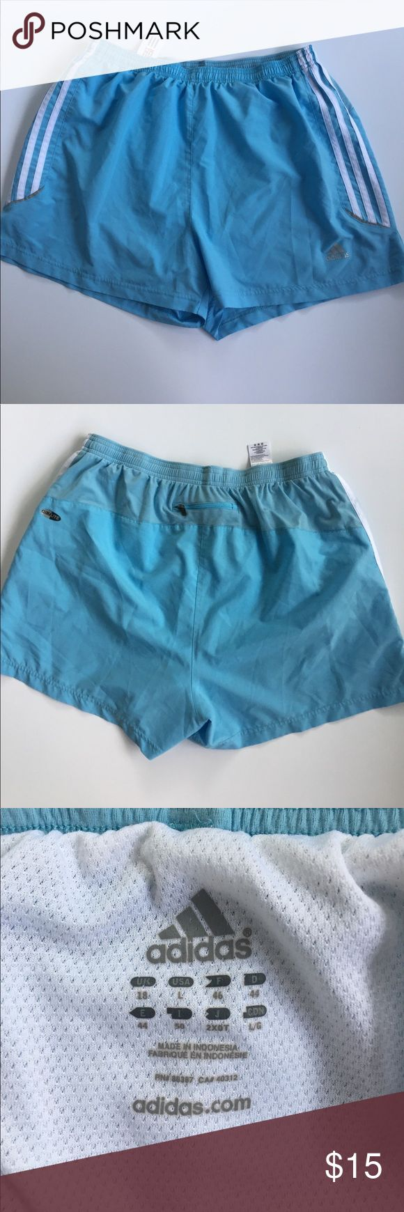Adidas light blue shorts This is a pair of light blue Adidas shorts. Size large. Elastic waist. Small zippered pocket in the back. Gently worn condition. No stains or holes. adidas Shorts