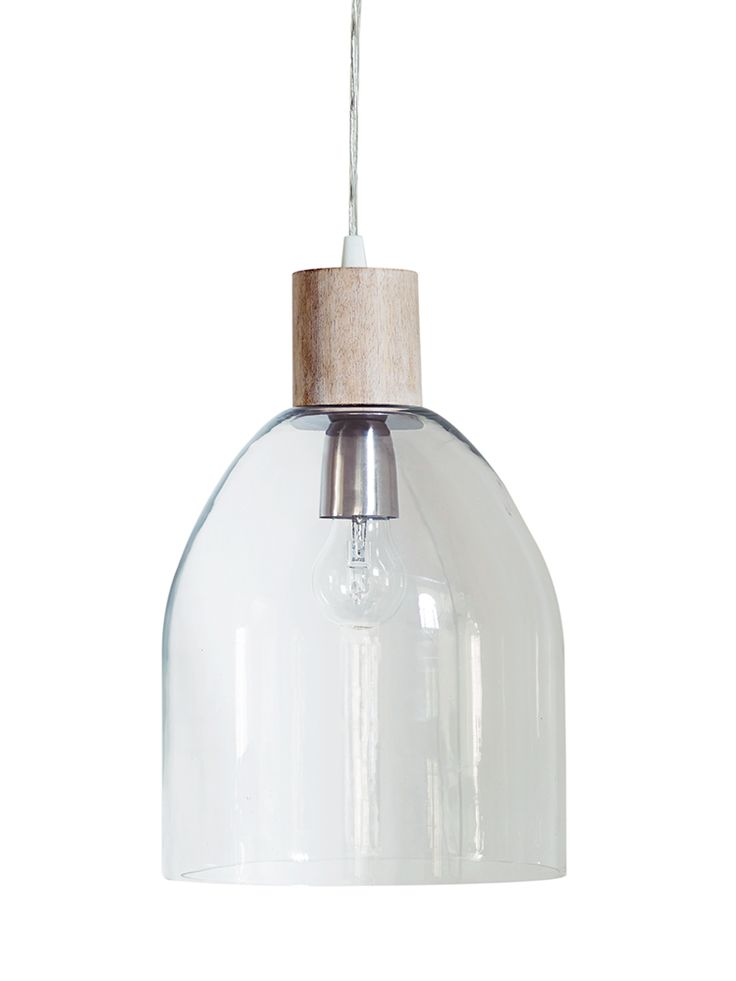 Carefully hand blown glass in a half-oval shaped, our contemporary dome glass pendant features a natural mango wood top and a simple clear flex. Easy to introduce to any interior, the clear glass and natural imperfections on this shade picks up the colours around it, casting beautiful light around your space.  Click here to view our useful lighting buying guide.