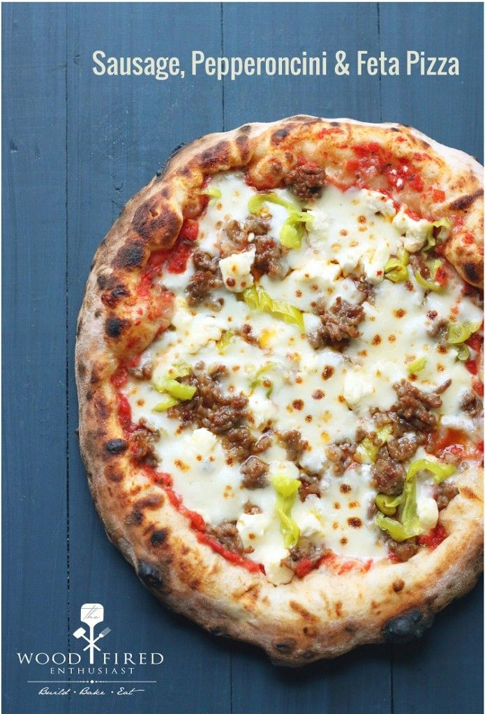 This fantastic Sausage, Pepperoncini and Feta pizza engages every single one of your taste buds!  The Wood Fired Enthusiast
